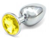 Malý anální kolík se žlutým krystalem