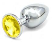 Anální kovový kolík se žlutým krystalem větší